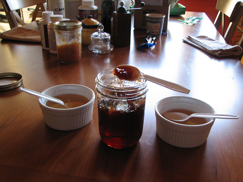 syrup, goo, jelly (jam in the background)
