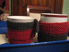 green and red mug cozies