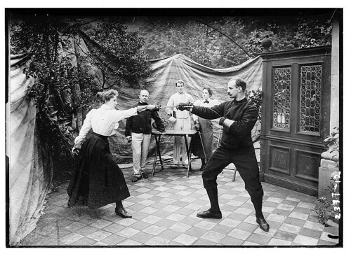 [man and woman fencing (?)]  (LOC)