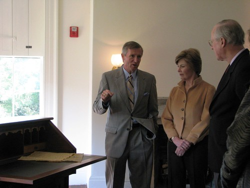 Director Frank Milligan, First Lady Laura Bush, and National Trust President Richard Moe view the desk in the Cottage.