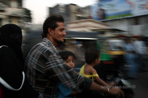 Family riding in Surat, India