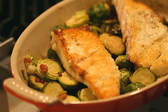Pan-Seared Halibut with Brussels Sprouts, Bacon, and Leeks in pan