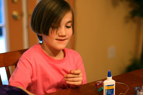 Naomi making a bead bracelet