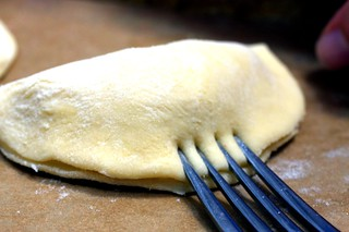 crimp the edges with a fork