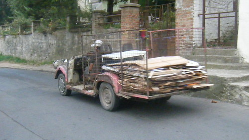 A Gypsiemobile cruising by with a load of cardboard.