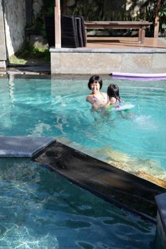 swimming at adi dharma cottage's pool
