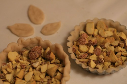 Tarts with chopped chestnuts and pastry leaf cutouts