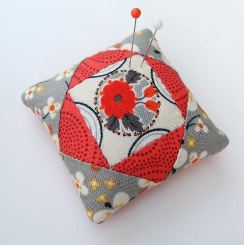 Orange flower pincushion