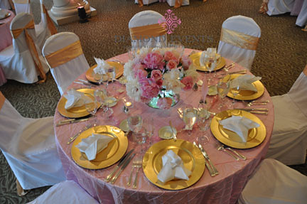Table setting in pink and gold at Harbour View Event Center