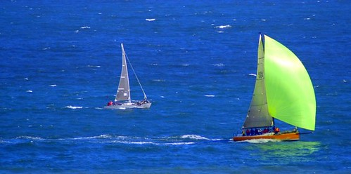 sailboat with a beautiful green sail