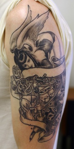 pinup girls tattoo | DESIGNS TATTOO. girl with pinup girls tattoo on her
