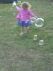 All a girl needs is bubbles.