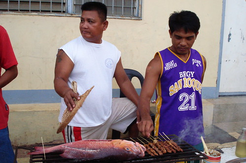 street vendor cooking barbeque for sale in the street of Busuanga, Palawan Philippines Buhay Pinoy  Ngayon Filipino Pilipino  people pictures photos life Philippinen  fish food seafood