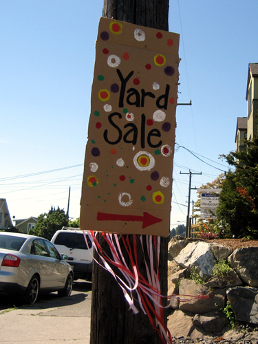 Colorful yard sale sign