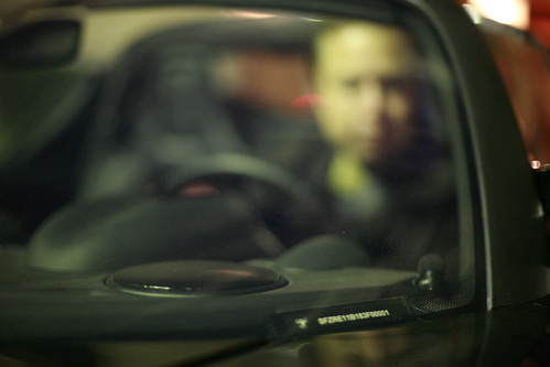 Elon Musk, Tesla Chairman, through windshield of first production Tesla
