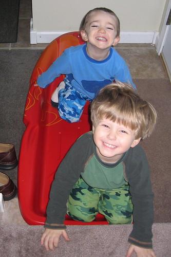 Jamie & V sledding in the hallway