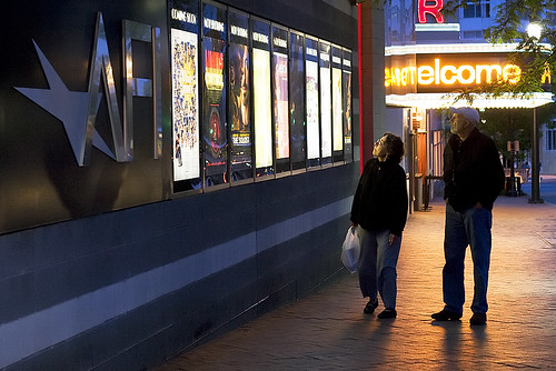 An elderly couple pauses to read the movie posters outside the AFI Silver movie theatre in downtown Silver Spring, Md.