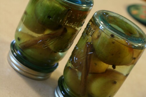 Pears in jars upside down to seal and cool