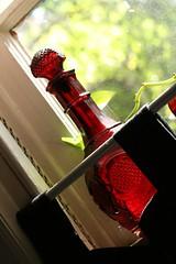 Ruby decanter in my kitchen window