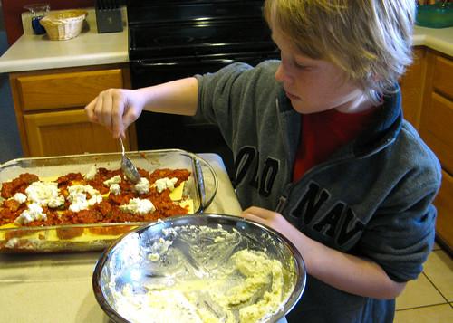 Justin assembles lasagne