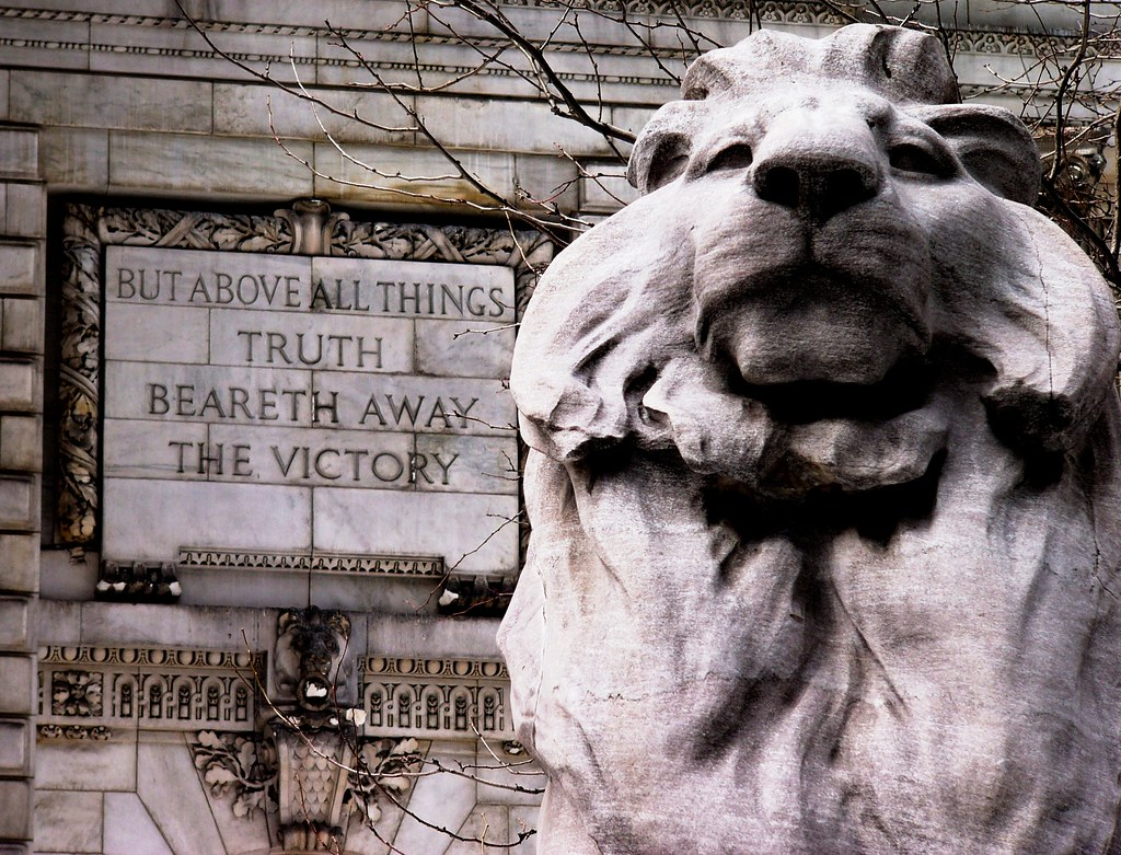 [One of the famous lions guarding the entrance to the NYPL]