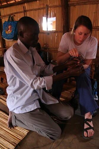 One of our students learns how to make the Invisible Children bracelets in Gulu, Uganda
