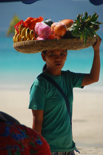 banana bilao onhead woman walking beach sea water snack fruit peddler banana saging pina piña pinay philippines walking filipinos