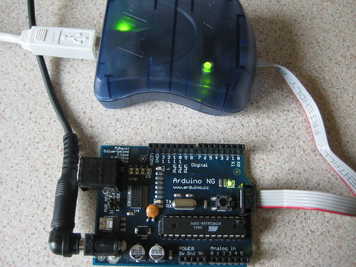 The Arduino is connected to the AVR ISP MKII which is burning a modified NG/Diecimila boot loader from Lady Ada.