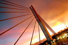 sunset by the bridge By Natalia Tjandra