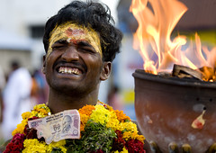 Suffering Man With Traditional Painting On His Forehead Holding A Jar On Fire During A Fire Walking Ritual, Madurai, South India