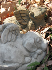 Dog and cat angel figures on leaves