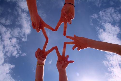 Five hands making a star shape