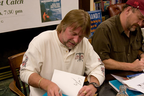 Capt Phil signing the Deadliest Catch book