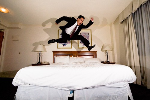 hotel room jump while wearing a suit