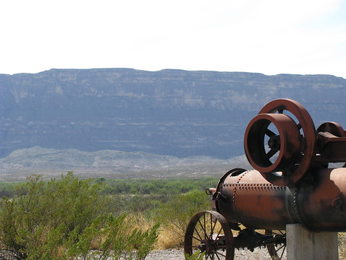 An old steam engine against the backdrop of the rockface below Santa Elena Canyon, near Castalon