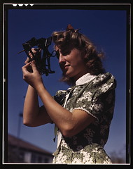 Learning how to determine latitude by using a sextant is Senta Osoling, student at Polytechnic High School, Los Angeles, Calif. Navigation classes are part of the school's program for training its students for specific contributions to the war effort (LOC