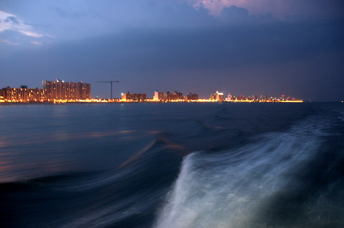 photo of the virginia beach skyline at dusk from a boat
