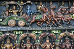 Wood carving of a scene from the Mahabharata