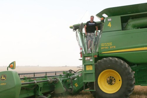 Rolly parks his combine for the day.