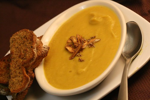Parsnip soup with fried garlic and mustard seed garnish