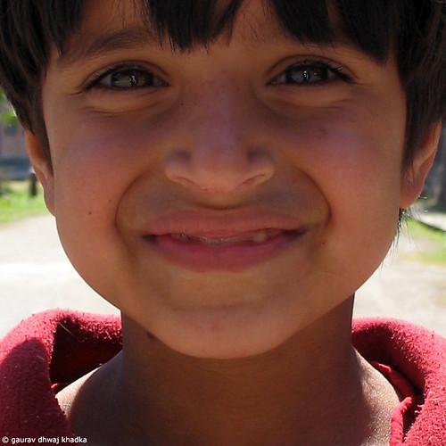 A little girl with a cute smile by Gaurav Dhwaj Khadka