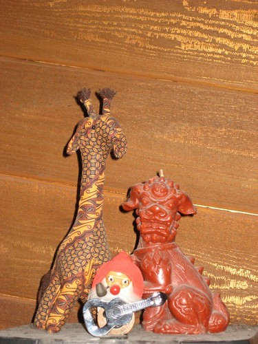 batik giraffe, mountain man bottle opener, Foo Dog candle