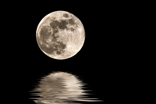The moon above a lake of digital water