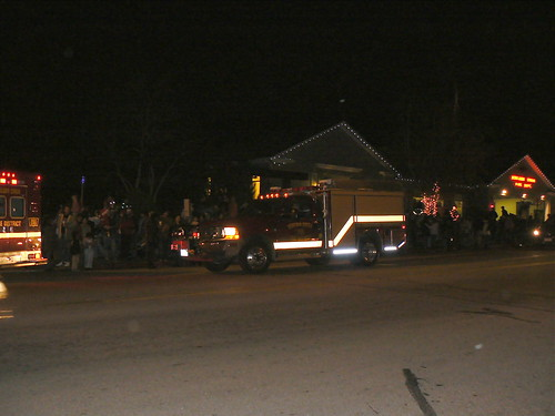 Fire trucks delivering Santa so he can light our tree