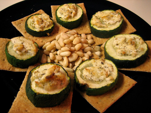 baked zucchini and goat cheese on crackers