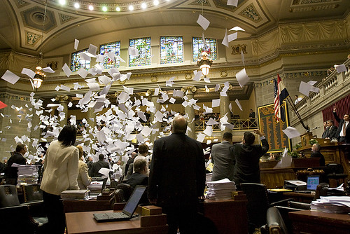 At the close of session, state representatives threw their papers into the air (a tradition).