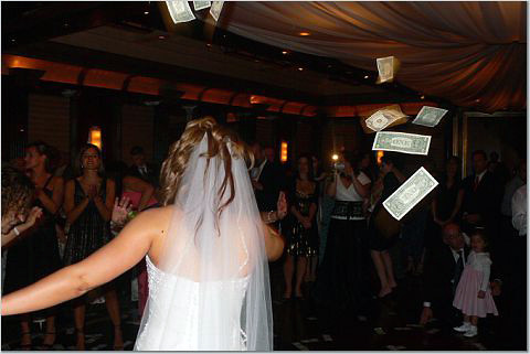throwing money at the bride on greek wedding