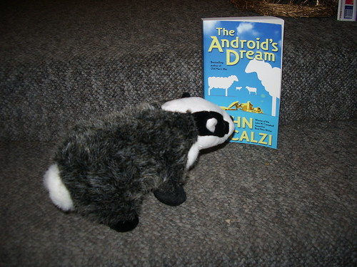 badger with book for scale