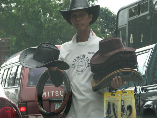 Ortigas ave Manila leather hat street vendor  Buhay Pinoy Philippines Filipino Pilipino  people pictures photos life Philippinen peddler
