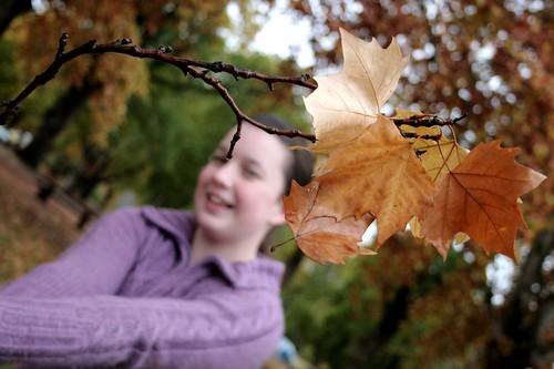 Britt with autumn leaves